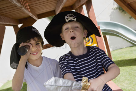 Posed : Little boy playing pirate