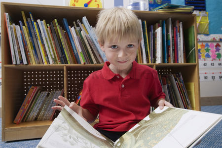 School : Little boy reading  picture book