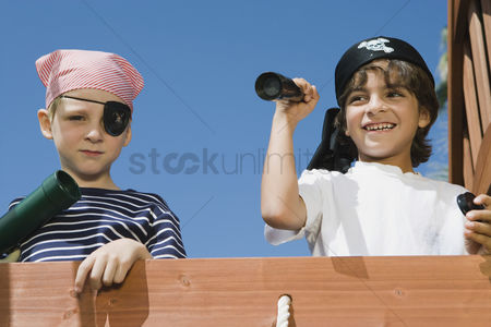 Posed : Little boys playing pirate
