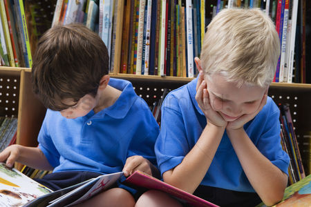 School children : Little boys reading picture books