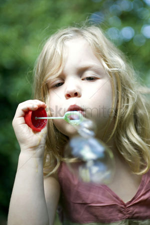 Blowing : Little girl playing bubbles