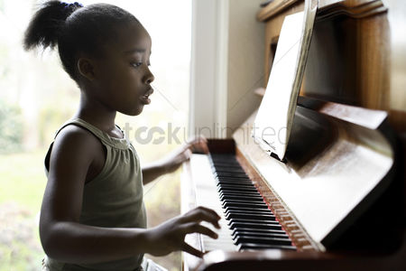 Curly hair : Little girl practicing piano