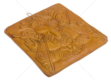 God : Lord ganesha engraved on a wooden block