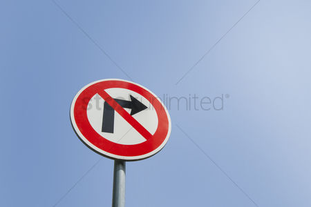 Forbidden : Low angle view of no right turn sign against clear sky
