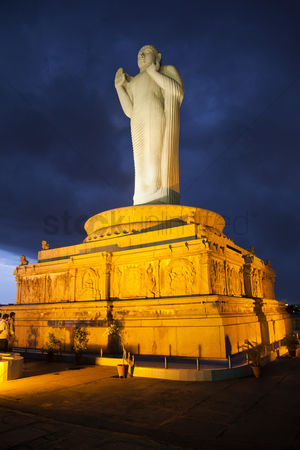 Sculpture : Low angle view of statue of lord buddha  hussain sagar lake  hyderabad  andhra pradesh  india