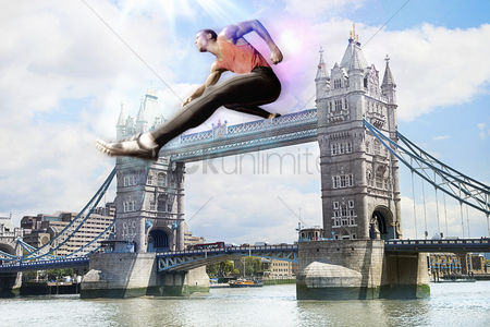 British ethnicity : Male athlete hurdling tower bridge