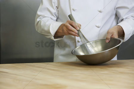 Bowl : Male chef mixing ingredients using whisk mid section