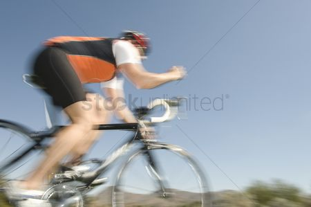 Arm raised : Male cyclist blurred motion