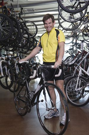 Proud : Male cyclist chooses a new bike