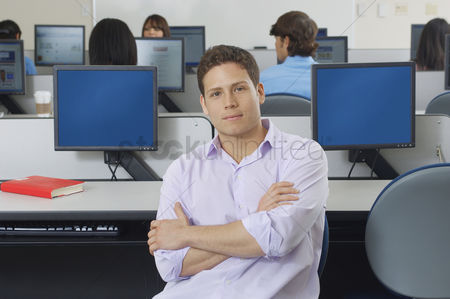 Pupil : Male student sitting in computer classroom portrait