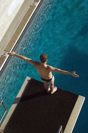 Diving : Male swimmer standing on diving board