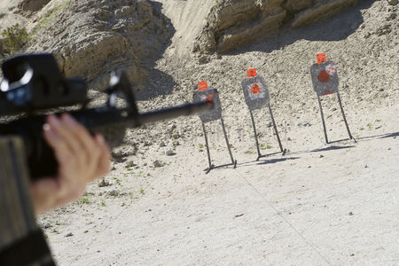 Firing : Man aiming machine gun at firing range close up of hands