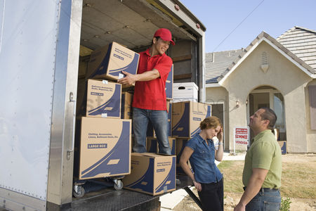 Truck : Man and couple unloading truck of cardboard boxes