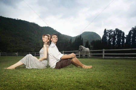 Grass : Man and woman sitting on grass