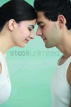 Girlfriend : Man and woman touching foreheads