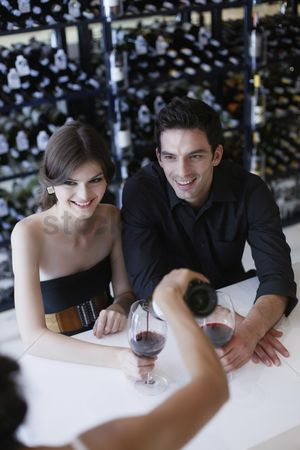 Wine bottle : Man and woman waiting for their wine to be poured