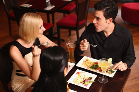 Refreshment : Man and women having dinner together