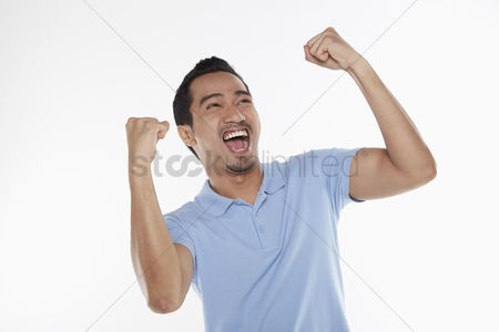 Masculinity : Man cheering with fist in the air