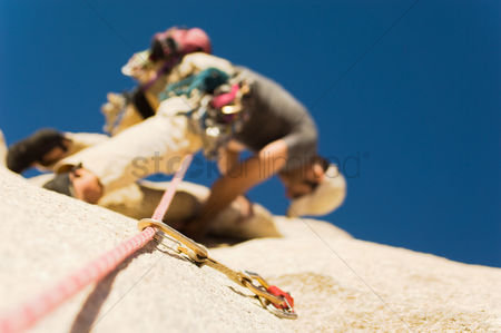 Rope : Man climbing on cliff view from below  low angle view