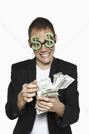 Dollar sign : Man counting money