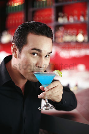 Satisfying : Man enjoying his glass of cocktail