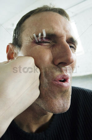 Pain : Man getting a punch on his face