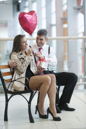 Czech republic : Man gives woman gift and heart shaped balloon