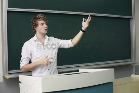 College : Man giving presentation from a podium