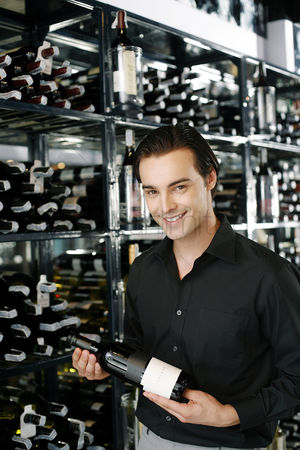 Tidy : Man holding a bottle of wine