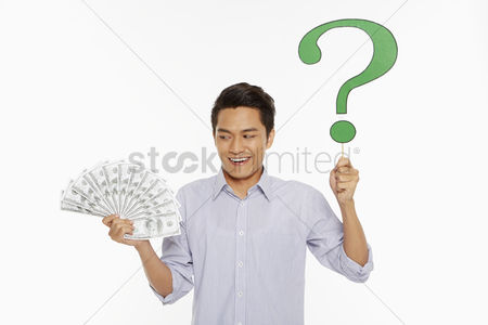 Masculinity : Man holding a pile of cash