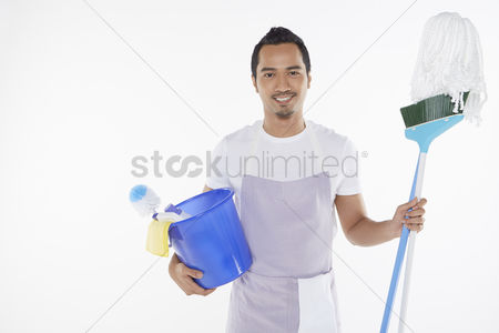 Masculinity : Man holding a variety of cleaning supplies