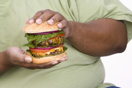 One man only : Man holding hamburger