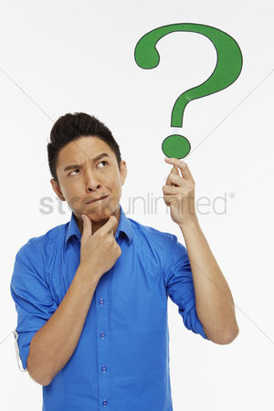 Thought : Man holding up a question mark symbol  contemplating