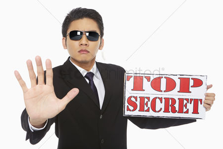 Malay : Man holding up a top secret