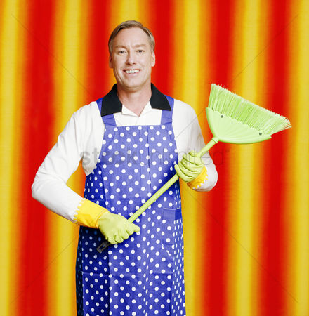 Tidy : Man in apron holding a broom