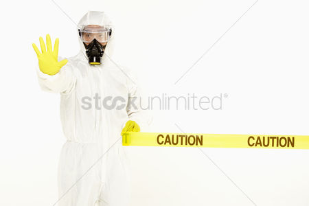 Masculinity : Man in protective suit showing hand gesture
