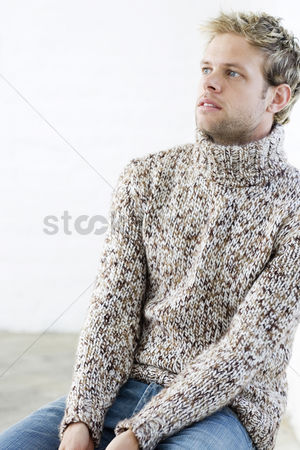 Wondering : Man in sweater thinking