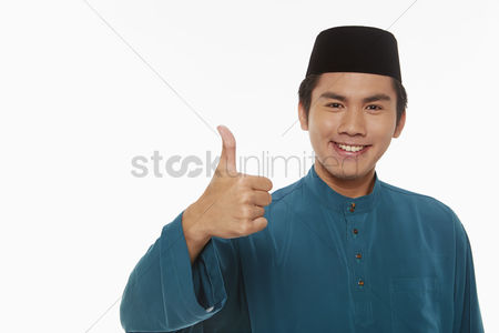 Traditional clothing : Man in traditional clothing giving thumbs up