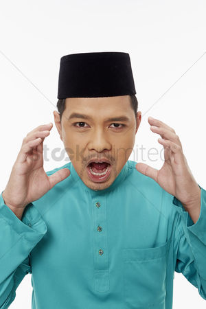 Baju melayu : Man in traditional clothing looking frustrated