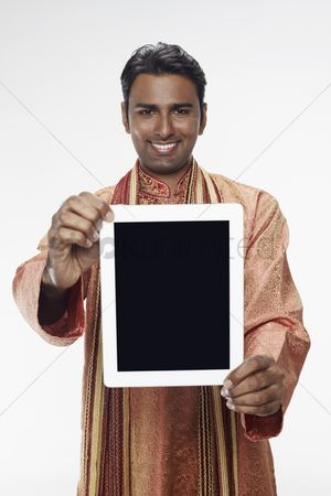 Portability : Man in traditional clothing showing digital tablet