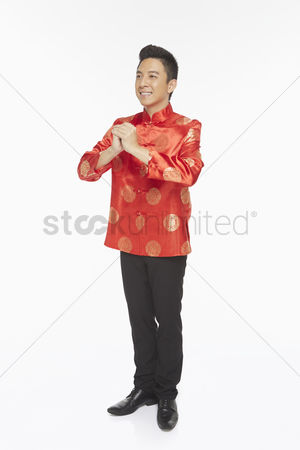 Lunar new year : Man in traditional clothing showing hand greeting gesture