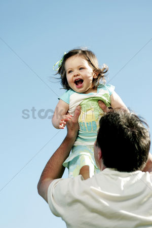Outdoor : Man lifting up his daughter