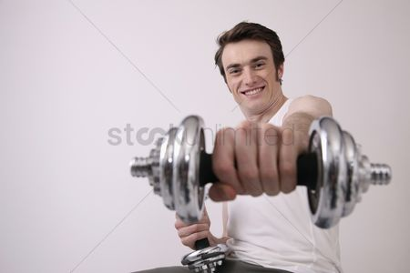 Dumbbell : Man lifting weights