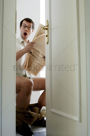 Bespectacled : Man on toilet bowl in shock
