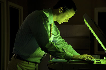 Interior : Man photocopying