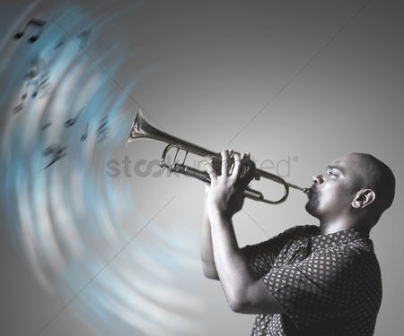 Blowing : Man playing trumpet and making music