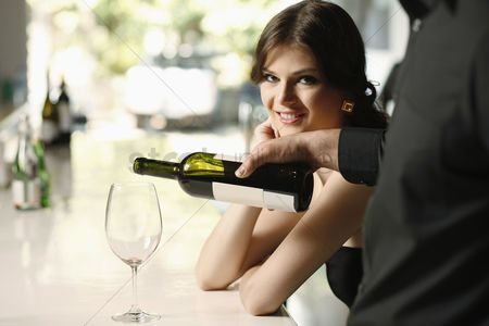 Wine bottle : Man pouring wine into woman s glass