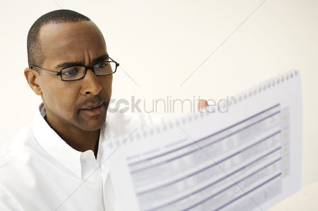 Business Finance : Man reading a document