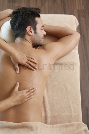 Body : Man receiving massage from a massage therapist