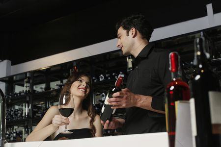 Wine bottle : Man recommending a bottle of wine to woman